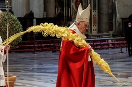 Pope Francis holds a mass on Palm Sunday, amid coronavirus disease (COVID-19) restrictions, in St. Peter's Basilica at the…