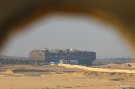 A view shows the stranded container ship Ever Given, one of the world's largest container ships, after it ran aground, in Suez…