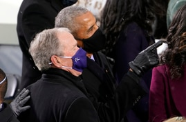 FILE - In this Jan. 20, 2021, file photo former President Barack Obama and former President George W. Bush look up to the crowd as they arrive for the 59th Presidential Inauguration at the U.S. Capitol for President-elect Joe Biden in Washington.