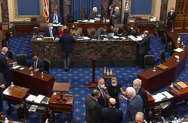 In this image from video, Republican senators and staff, lower right, talk on the floor after a vote on the motion to allow…