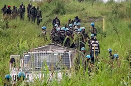 United Nations peacekeepers recover bodies from an area near the site where a U.N. convoy was attacked in Nyiragongo, North…