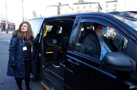 Dr Sharon Raymond with one of the London Taxi cabs being used as a Vaxi Taxi during the pilot project of pop up vaccination…
