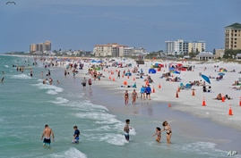 Beachgoers take advantage of the sun, sand, and surf as they spend time on Clearwater Beach Tuesday, March 2, 2021, in…