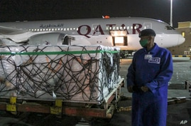The first arrival of COVID-19 vaccines to Kenya is offloaded from a Qatar Airways flight at Jomo Kenyatta International Airport in Nairobi, Kenya, March 3, 2021.