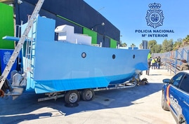 In this photo provided by the Spanish National police on Friday March 12, 2021, a homemade semi submersible submarine sits…