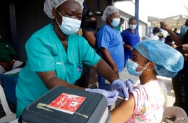 Hospital staff receives one of the country's first coronavirus vaccinations using AstraZeneca COVID-19 vaccine manufactured by…