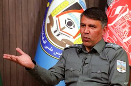 Afghan Interior Minister Masoud Andarabi speaks during an interview to the Associated Press at the Ministry of the Interior in…