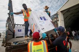 Boxes of AstraZeneca COVID-19 vaccine manufactured by the Serum Institute of India and provided through the global COVAX initiative arrive at the airport in Mogadishu, Somalia, March 15, 2021.