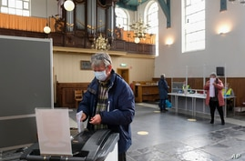 People vote in general elections in a church in the village of Ransdorp, near Amsterdam, Netherlands, March 17, 2021.