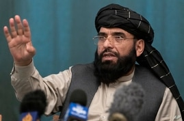 Suhail Shaheen, member of negotiation team gestures while speaking during a joint news conference in Moscow, Russia, Friday,…
