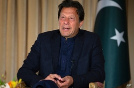 FILE - In this March 16, 2020, file photo, Pakistan's Prime Minister Imran Khan gives an interview to The Associated Press, in…