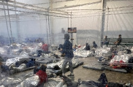 This March 20, 2021, photo provided by the Office of Rep. Henry Cuellar, D-Texas, shows detainees in a Customs and Border…