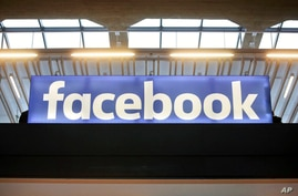 FILE - In this Tuesday, Jan. 17, 2017, file photo, the Facebook logo is displayed at a gathering for startup companies at Paris…