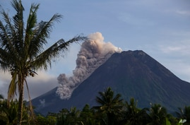 Mount Merapi releases volcanic materials down its slope during an eruption in Sleman, Indonesia, Saturday, March 27, 2021…