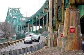 Drivers take an exit ramp off the Tobin Memorial Bridge, Wednesday, March 31, 2021, in Chelsea, Mass. President Joe Biden wants…