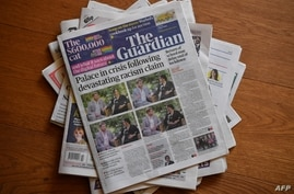 An arrangement of UK daily newspapers photographed as an illustration in Brenchley, Kent, March 9, 2021, shows front page headlines reporting on the story of the interview given by Meghan, Duchess of Sussex, wife of Prince Harry, to Oprah Winfrey.