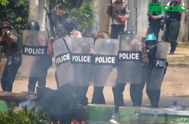 This screengrab provided via AFPTV and taken from a broadcast by Myitkyina News Journal on March 27, 2021 shows security forces crack down protesters during a demonstration against the military coup in Myitkyina in Myanmar's Kachin state.