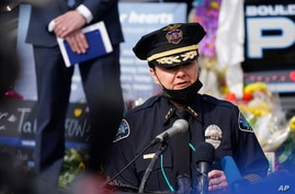 Boulder Police Department Chief Maris Herold speaks at a news conference outside police headquarters, in Boulder, Colorado, March 26, 2021.