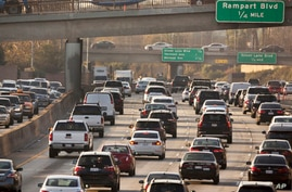 FILE - Traffic moves along the Hollywood Freeway in Los Angeles, California, Dec. 12, 2018.