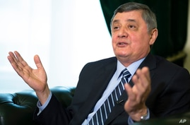 FILE - Russian envoy to Afghanistan Zamir Kabulov speaks during an interview with The Associated Press in Moscow, Feb. 13, 2019.