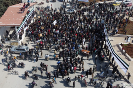 """protest: After ten years of war, protesters still gather in """"Seven Lakes"""" roundabout to call for the fall of the government on Feb.26, 2021 in Idlib, Syria (VOA/Mohammad Daboul)"""