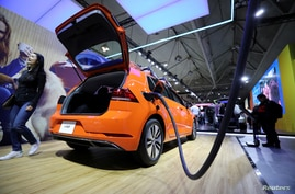 FILE - A Volkswagen E-Golf electric vehicle is seen at the Canadian International Auto Show in Toronto, Canada, Feb. 18, 2020.