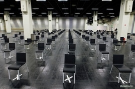 Empty chairs are seen at a makeshift COVID-19 vaccination site in Cologne, Germany, March 18, 2021.