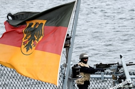 FILE - A gunner stands in position aboard a German Navy frigate during exercises in the Baltic Sea, near Rostock, Germany, Sept. 11, 2019.