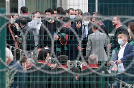 Lawyers who were not allowed inside wait outside the Sincan Penal Institutions Campus  in support as opens the trial two former…
