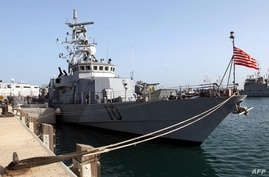This photo released by the US Navy 13 March 2003, shows the US Navy patrol boat USS Firebolt (PC 10) moored in port displaying…