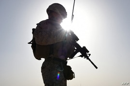 In this photograph taken on August 27, 2017 a US Marine watches Afghan Commandos take part in a combat training exercise at…