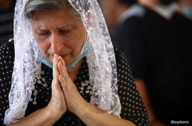 A woman attends a Sunday service at a church that was damaged following Tuesday's blast in Beirut's port area, Lebanon August 9…
