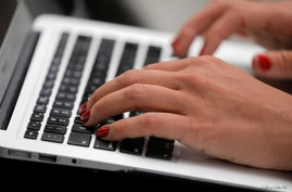 A person types on a laptop computer in Manhattan, New York City, September 11, 2020.
