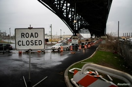 A street is closed due to work in the road in Jersey City, New Jersey, U.S. March 31, 2021.