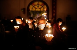 People attend an Easter Vigil service, amid the coronavirus disease (COVID-19) outbreak, at a Catholic church in Shanghai.