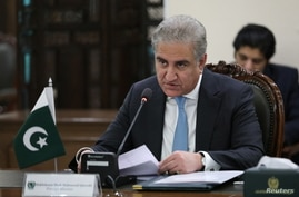 Pakistani Foreign Minister Shah Mehmood Qureshi attends a meeting with his Russian counterpart Sergei Lavrov in Islamabad,…