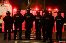 Police officers stand in formation during a protest in the Loyalist Tigers Bay Area of Belfast, Northern Ireland April 9, 2021…