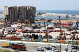 FILE PHOTO: Vehicles drive near the grain silo that was damaged during Beirut port explosion, in Beirut, Lebanon April 9, 2021…