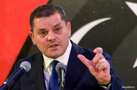FILE PHOTO: Libya's new Prime Minister Abdulhamid Dbeibeh, speaks during a news conference in Tripoli, Libya February 25, 2021…