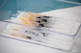 Syringes with AstraZeneca coronavirus disease (COVID-19) vaccines are prepared in Fasano Italy, April 13, 2021. REUTERS…