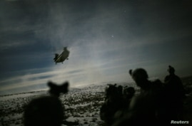 FILE PHOTO: A Chinook helicopter lands to pick up U.S. soldiers of the 101st Airborne Division following a night raid in Yahya…