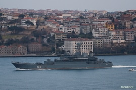 The Russian Navy's Ropucha-class landing ship Korolev sets sail in the Bosphorus, on its way to the Black Sea, in Istanbul,…