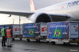 Refrigerated containers with supplies to produce China's Sinovac vaccines against the coronavirus disease (COVID-19) arrive at…