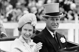 FILE - In this June 19, 1962 file photo, Britain's Prince Philip and his wife Queen Elizabeth II arrive at Royal Ascot race.
