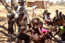 Children shelter from the sun in Ankilimarovahatsy, Madagascar,  a village in the far south of the island where most children…