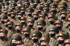 FILE - In this Oct 12, 2020, file photo, soldiers wearing face masks to help curb the spread of the coronavirus rally to…