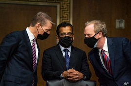 FireEye CEO Kevin Mandia, SolarWinds CEO Sudhakar Ramakrishna and Microsoft President Brad Smith talk to each other before a Senate Intelligence Committee hearing on Capitol Hill on Feb. 23, 2021 in Washington.