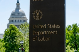 FILE - In this May 7, 2020, file photo, the entrance to the Labor Department is seen near the Capitol in Washington…
