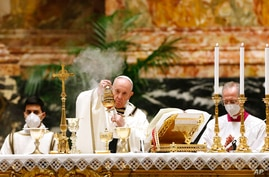 Pope Francis celebrates the Easter Vigil in a nearly empty St. Peter's Basilica as coronavirus pandemic restrictions stay in…