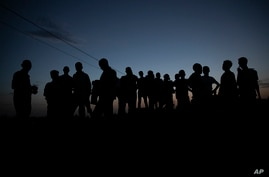 Tigrayan refugees who fled the conflict in the Ethiopia's Tigray gather after the sun sets in Hamdayet, eastern Sudan, near the…